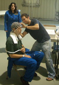Karl, a pilot and experimental subject, prepares to have his mind read by EEG, as researcher Greg makes sure the electrodes make good contact with the skin. (Don't ask what that expression on my face is all about, I've no idea…)